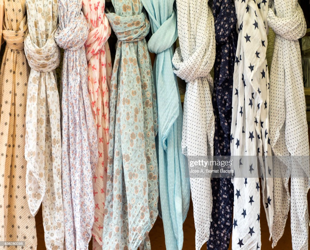 Full Frame Shot Of Colorful Scarves Hanging At Market For Sale in outdoor. Street market in Begur, Catalonia, Spain : Stock Photo