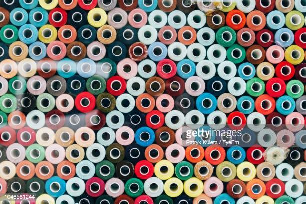 Full Frame Shot Of Colorful Spools For Sale In Store Seen Through Glass Window