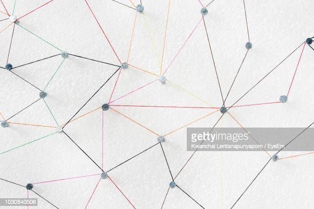 Full Frame Shot Of Colorful Strings Connected To Nails
