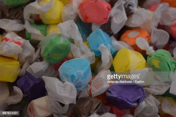 full frame shot of colorful taffies at market stall for sale - candy wrapper stock photos and pictures