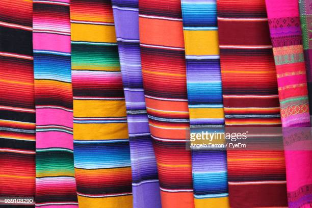 full frame shot of colorful textiles for sale in market - メキシコ ストックフォトと画像