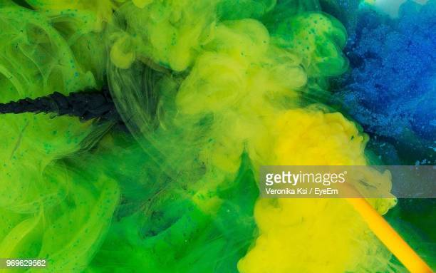 full frame shot of colors dissolving in liquid - ksi stock photos and pictures