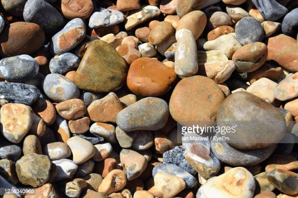 full frame shot of colourful pebbles on beach - pebble stock pictures, royalty-free photos & images