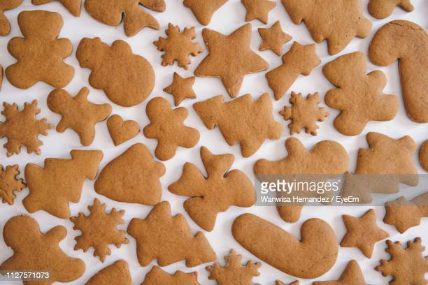full frame shot of cookies on table - gingerbread cookie stock pictures, royalty-free photos & images