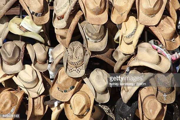 full frame shot of cowboy hats for sale at street market - cowboy hat stock pictures, royalty-free photos & images
