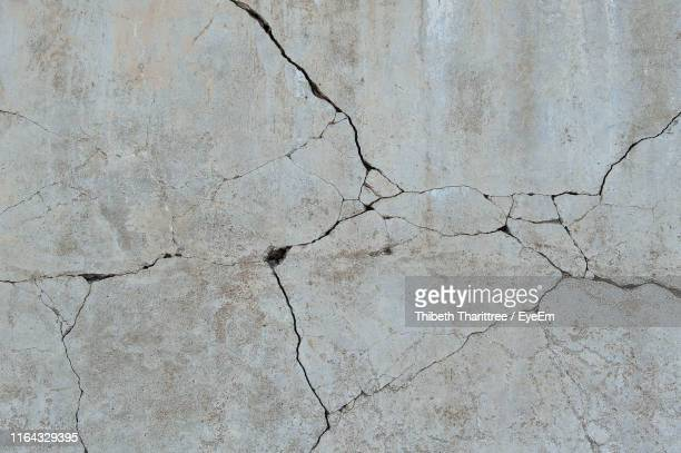 full frame shot of cracked wall - concrete stock pictures, royalty-free photos & images