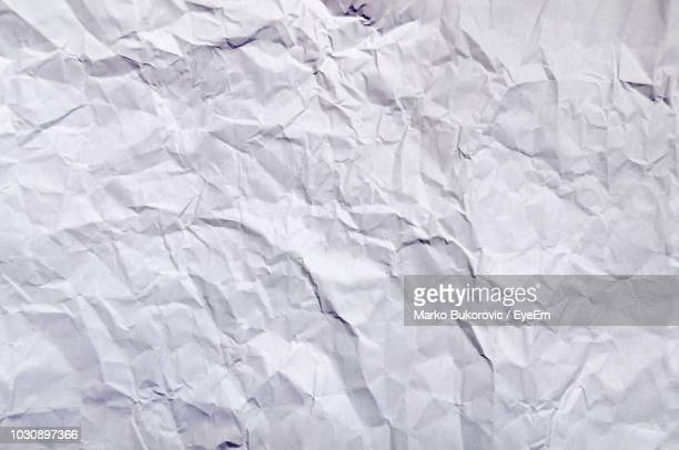 full frame shot of crumpled paper - crushed stock pictures, royalty-free photos & images