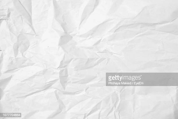 full frame shot of crumpled paper - papier stock-fotos und bilder