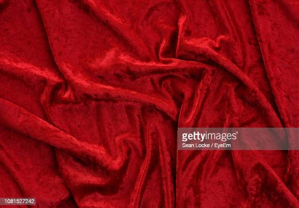 full frame shot of crumpled red sheet - velvet stock pictures, royalty-free photos & images