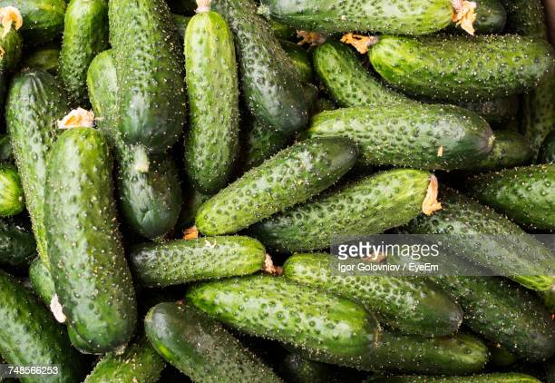 full frame shot of cucumbers for sale at market - igor golovniov stock pictures, royalty-free photos & images