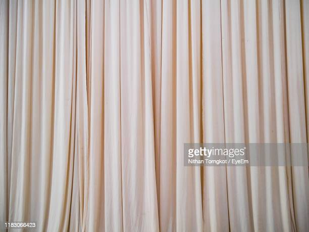 full frame shot of curtain hanging - curtain stock pictures, royalty-free photos & images
