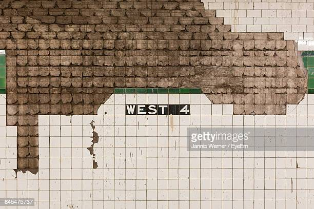 Full Frame Shot Of Damaged Tiled Wall At Subway Station