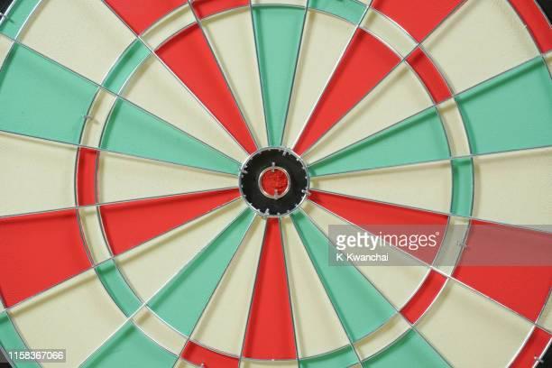 full frame shot of dartboard - zielscheibe stock-fotos und bilder