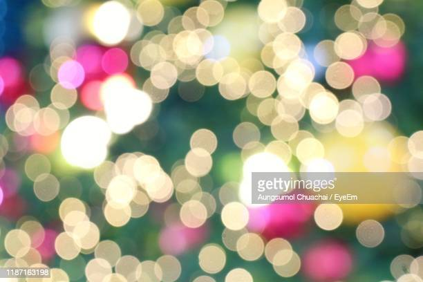 full frame shot of defocused illuminated lights - aungsumol stock pictures, royalty-free photos & images