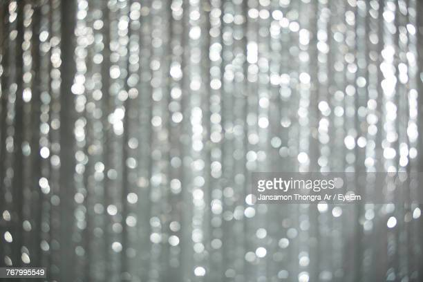 full frame shot of defocused illuminated lights - silver coloured stock pictures, royalty-free photos & images