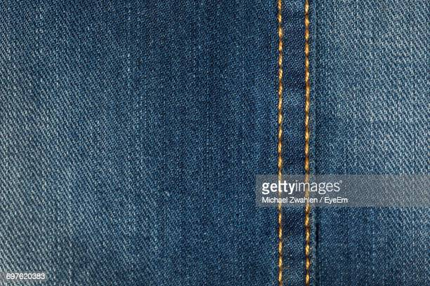 full frame shot of denim jeans - spijkerbroek stockfoto's en -beelden