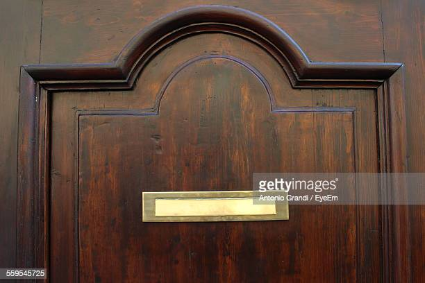 full frame shot of door - nameplate stock pictures, royalty-free photos & images