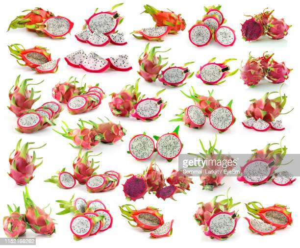 full frame shot of dragon fruits against white background - dragon fruit stock pictures, royalty-free photos & images