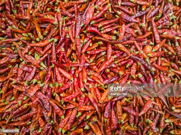 full frame shot of dry red chili pepper - sichuan province stock pictures, royalty-free photos & images