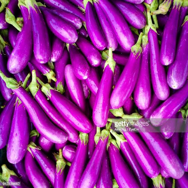 full frame shot of eggplants for sale in market - eggplant stock photos and pictures