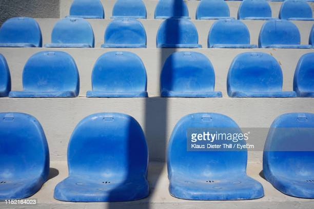 Full Frame Shot Of Empty Blue Seats At Stadium