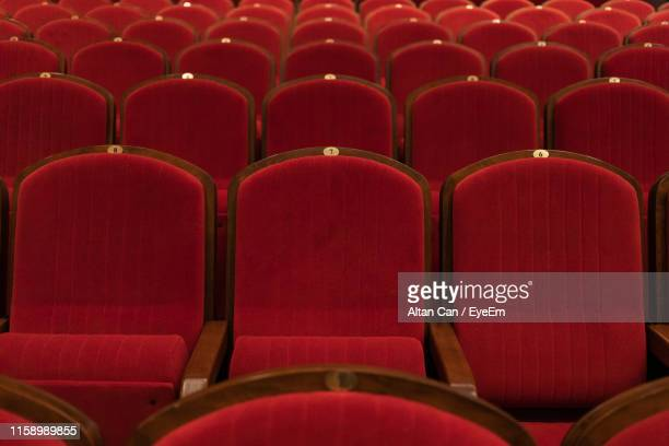 full frame shot of empty chairs in movie theater - 席 ストックフォトと画像