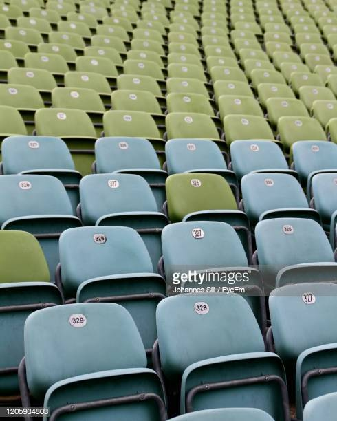 full frame shot of empty chairs in stadium - sport venue stock pictures, royalty-free photos & images