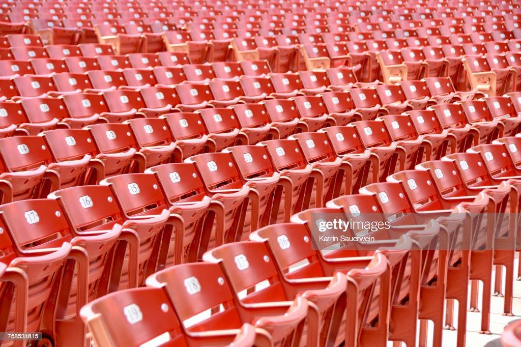 Full Frame Shot Of Empty Chairs In Statium : Stock Photo