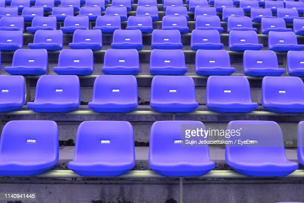 full frame shot of empty purple seats at stadium - bleachers stock pictures, royalty-free photos & images
