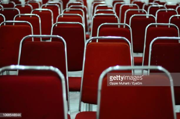 full frame shot of empty red chairs - oppie muharti stock pictures, royalty-free photos & images