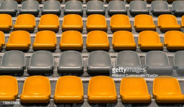 full frame shot of empty stadium chairs - empty bleachers stock photos and pictures