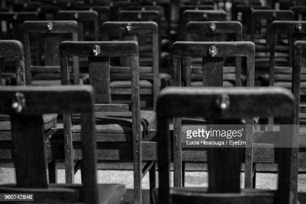 Full Frame Shot Of Empty Wooden Chairs