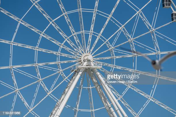 full frame shot of ferris wheel against clear blue sky - atlantic city stock pictures, royalty-free photos & images