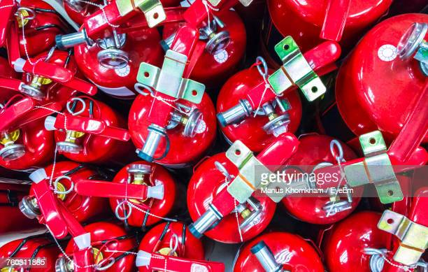 full frame shot of fire extinguishers - fire extinguisher stock photos and pictures