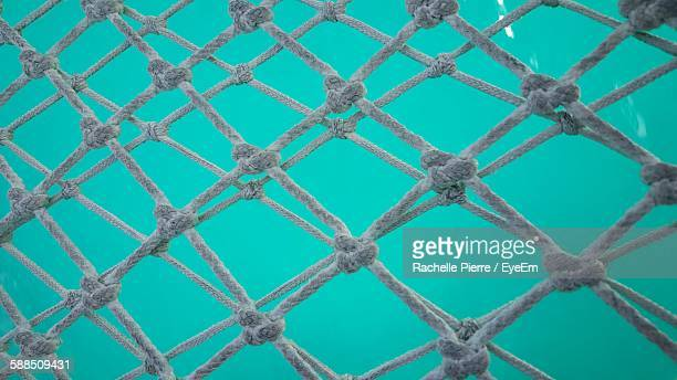 Full Frame Shot Of Fishing Net Undersea