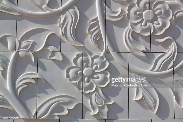 full frame shot of floral pattern on white wall - carving craft product stock pictures, royalty-free photos & images