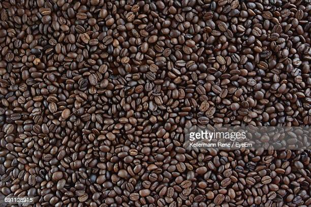 full frame shot of fresh coffee beans - roasted coffee bean stock photos and pictures