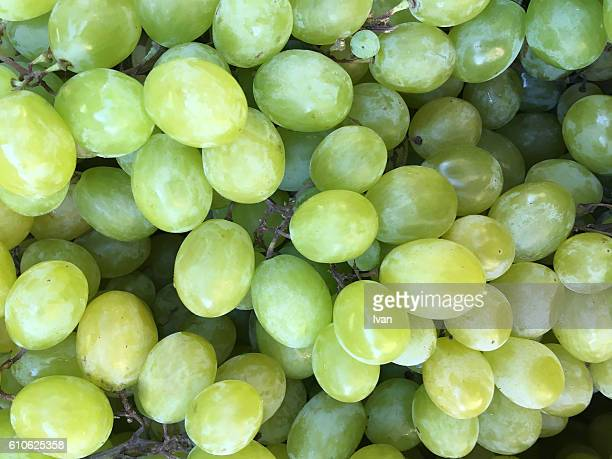 full frame shot of fresh organic green grapes in market - white grape stock photos and pictures