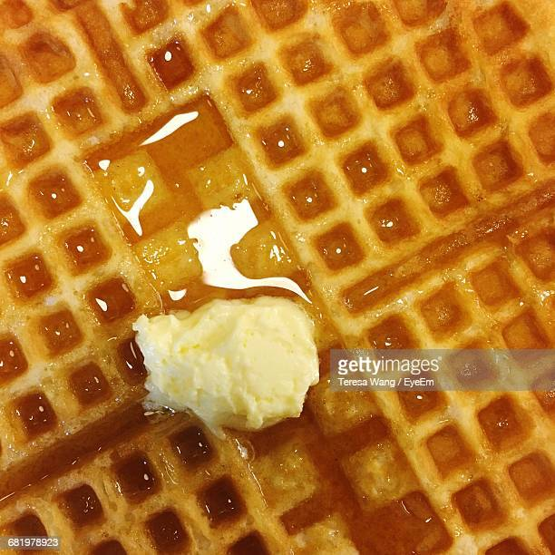 Full Frame Shot Of Fresh Waffle With Butter And Syrup
