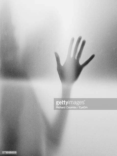 Full Frame Shot Of Frosted Glass With Hand Shadow