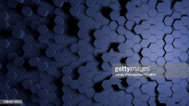 full frame shot of geometric shapes - honeycomb stock pictures, royalty-free photos & images