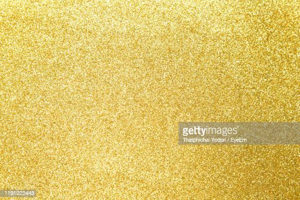 full frame shot of golden background - gold colored stock pictures, royalty-free photos & images