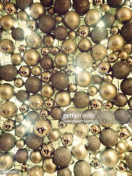 Full Frame Shot Of Golden Baubles