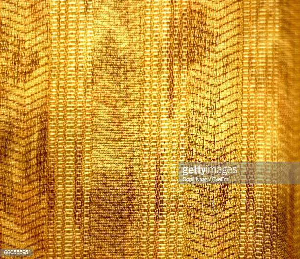 Full Frame Shot Of Golden Curtain