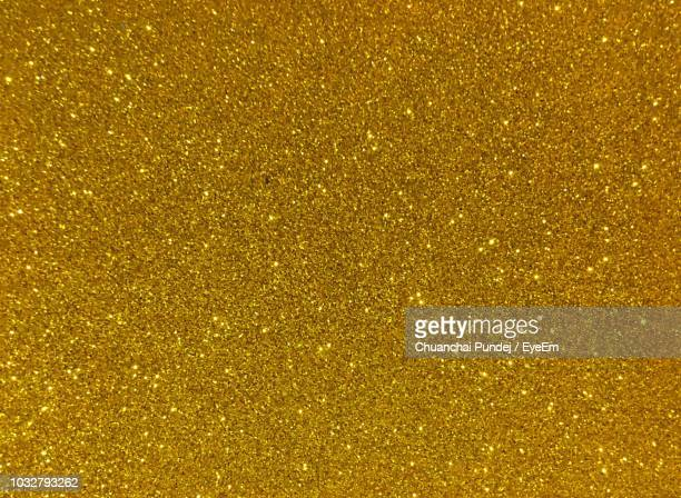 full frame shot of golden glitter - gold stock pictures, royalty-free photos & images