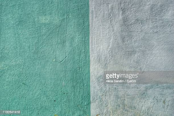 Full Frame Shot Of Gray And Turquoise Colored Wall