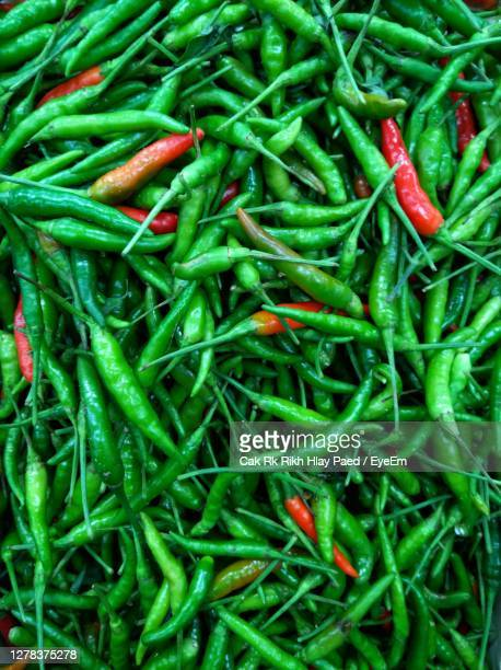 full frame shot of green chili peppers - green chili pepper stock pictures, royalty-free photos & images