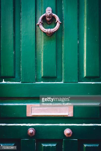 full frame shot of green door - door knocker stock photos and pictures