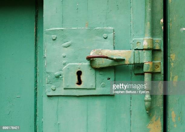 Full Frame Shot Of Green Door With Old Latch