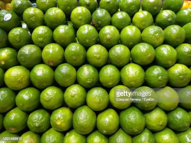 full frame shot of green lemons - lime stock pictures, royalty-free photos & images